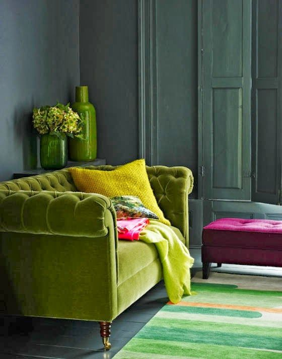 Lime green Chesterfield sofa in a designer living room with accents of hot pink